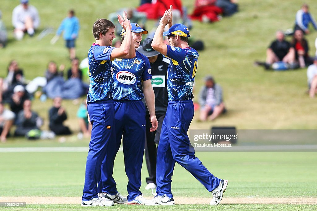 Jacob Duffy (L) of Otago celebrates during the Twenty20 match between Otago and Auckland at Queenstown Events Centre on December 31, 2012 in Queenstown, New Zealand.