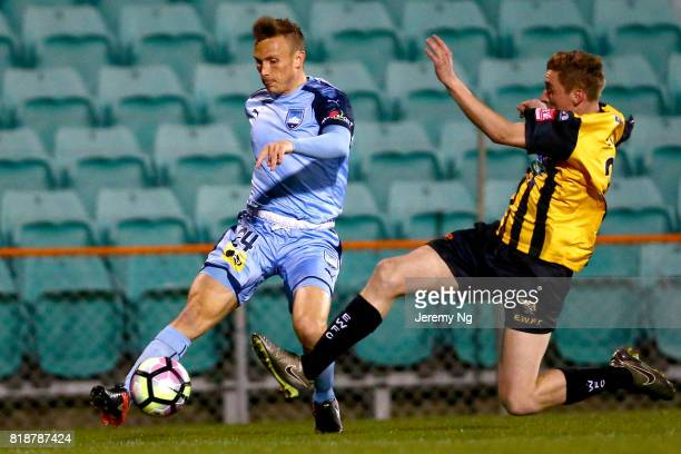 Jacob Esposito of Sydney FC kicks the ball under pressure during the 2017 Johnny Warren Challenge match between Sydney FC and Earlwood Wanderers at...