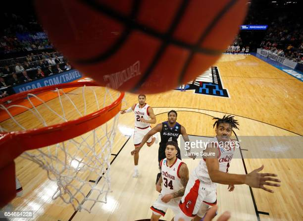 Jacob Evans III of the Cincinnati Bearcats leaps for a rebound during the first round of the NCAA Basketball Tournament against the Kansas State...