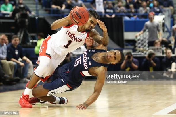 Jacob Evans of the Cincinnati Bearcats collides with Rodney Purvis of the Connecticut Huskies during the semifinal round of the AAC Basketball...