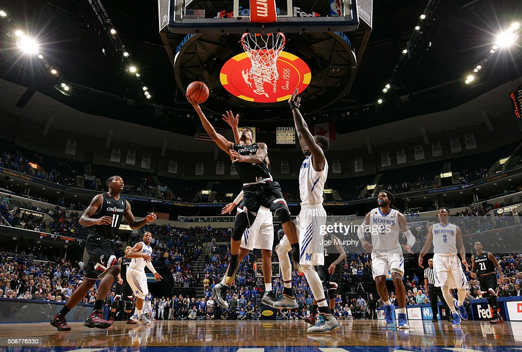 Jacob Evans #1 of the Cincinnati Bearcats drives to the basket for a layup against Trahson Burrell #0 of the Memphis Tigers on February 6, 2016 at FedExForum in Memphis. Memphis defeated Cincinnati 63-59.