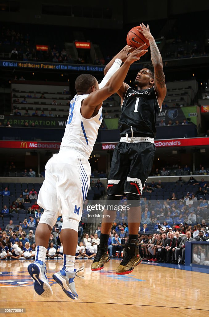 Jacob Evans #1 of the Cincinnati Bearcats shoots a jumpshot against Sam Craft #23 of the Memphis Tigers on February 6, 2016 at FedExForum in Memphis. Memphis defeated Cincinnati 63-59.