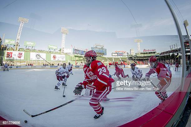 Jacob Forsbacka Karlsson of Boston University handles the buck before scoring a goal during the first period of a Frozen Fenway game against the...