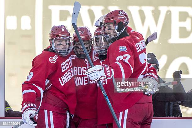 Jacob Forsbacka Karlsson of Boston University reacts with teammates after scoring a goal during the first period of a Frozen Fenway game against the...