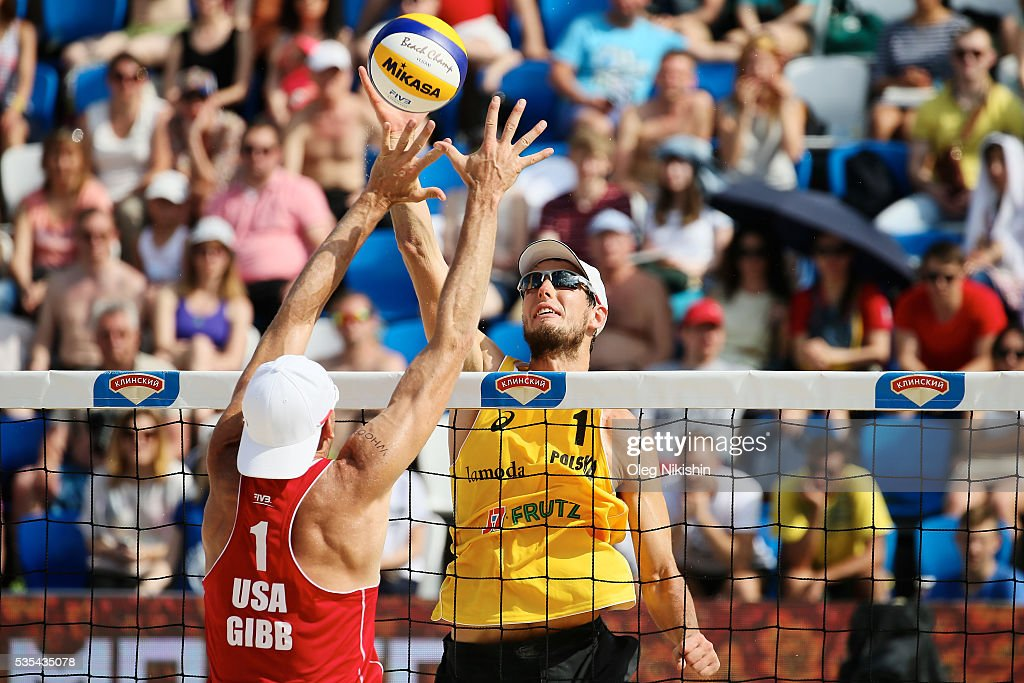 Jacob Gibb (L) of USA and Piotr Kantor of Poland duel at the net during a game between USA and Poland on day 6 of the FIVB Moscow Grand Slam at sports complex Dynamo Vodny Stadium on May 29, 2016 in Moscow, Russia.