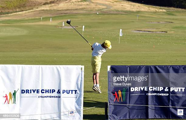 Jacob Gouker hits his drive during the Drive competition in the Boys 1011 yr old division of the Drive Chip and Putt regional qualifying at Chambers...
