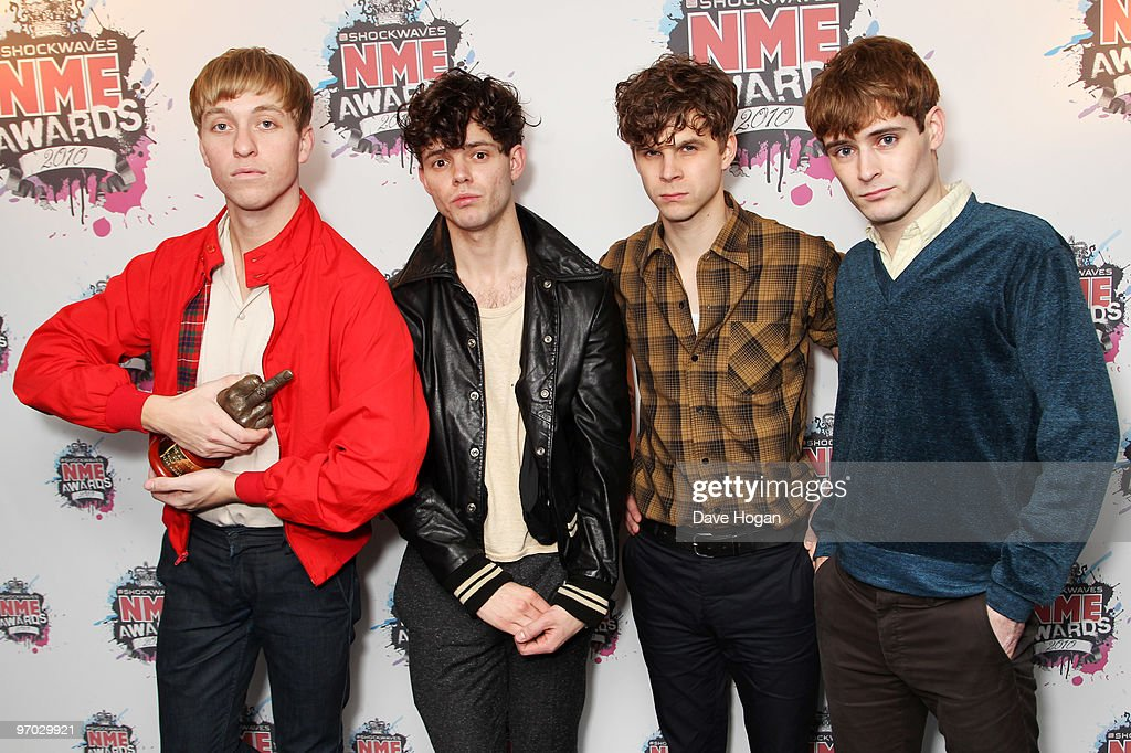 Jacob Graham, Connor Hanwick, Adam Kessler and Jonathon Pierce of The Drums pose with the Phillip Hall radar award in front of the winners boards at the Shockwaves NME Awards 2010 held at Brixton Academy on February 24, 2010 in London, England.