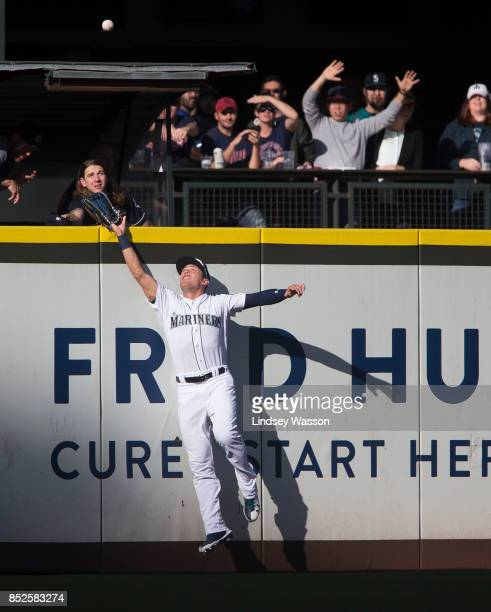Jacob Hannemann of the Seattle Mariners can't catch the home run by Yan Gomes of the Cleveland Indians in the ninth inning at Safeco Field on...