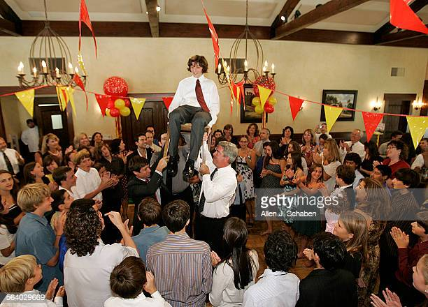 Jacob Hauptman is hoisted above his family and friends on a chair during his Bar Mitzvah attended by his grandmother Charlotte Hauptman who survived...