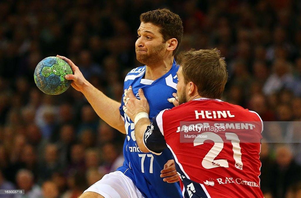Jacob Heinl of Flensburg (R) is challenged by Chen Pomeranz (L) of Grosswallstadt during the DKB Handball Bundesliga match between SG Flensburg-Handewitt and TV Grosswallstadt at Flens Arena on March 3, 2013 in Flensburg, Germany.