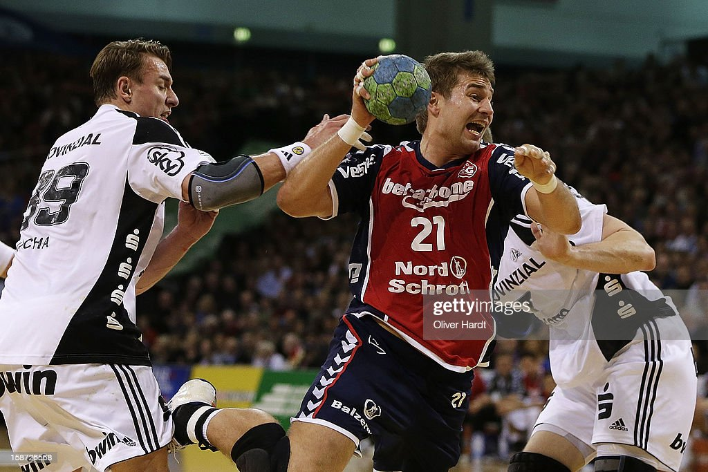 Jacob Heinl (R) of Flensburg is challenged by Filip Jicha (L) of Kiel during the DKB Handball Bundesliga match between Flensburg-Handewitt and THW Kiel at Campus Hall on December 26, 2012 in Flensburg, Germany.