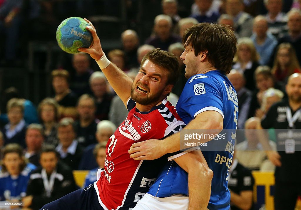Jacob Heinl of Flensburg (L) is challenged by Steffen Buehler (R) of Grosswallstadt during the DKB Handball Bundesliga match between SG Flensburg-Handewitt and TV Grosswallstadt at Flens Arena on March 3, 2013 in Flensburg, Germany.