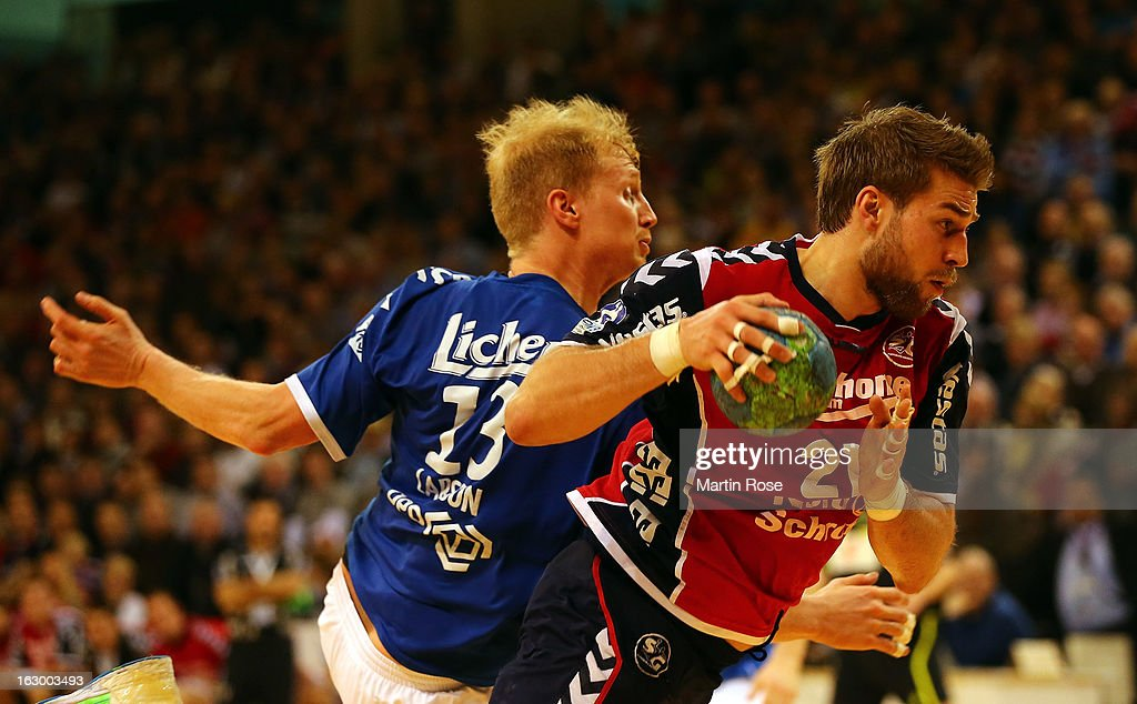 Jacob Heinl of Flensburg (R) is challenged by Steffen Weinhold (L) of Grosswallstadt during the DKB Handball Bundesliga match between SG Flensburg-Handewitt and TV Grosswallstadt at Flens Arena on March 3, 2013 in Flensburg, Germany.