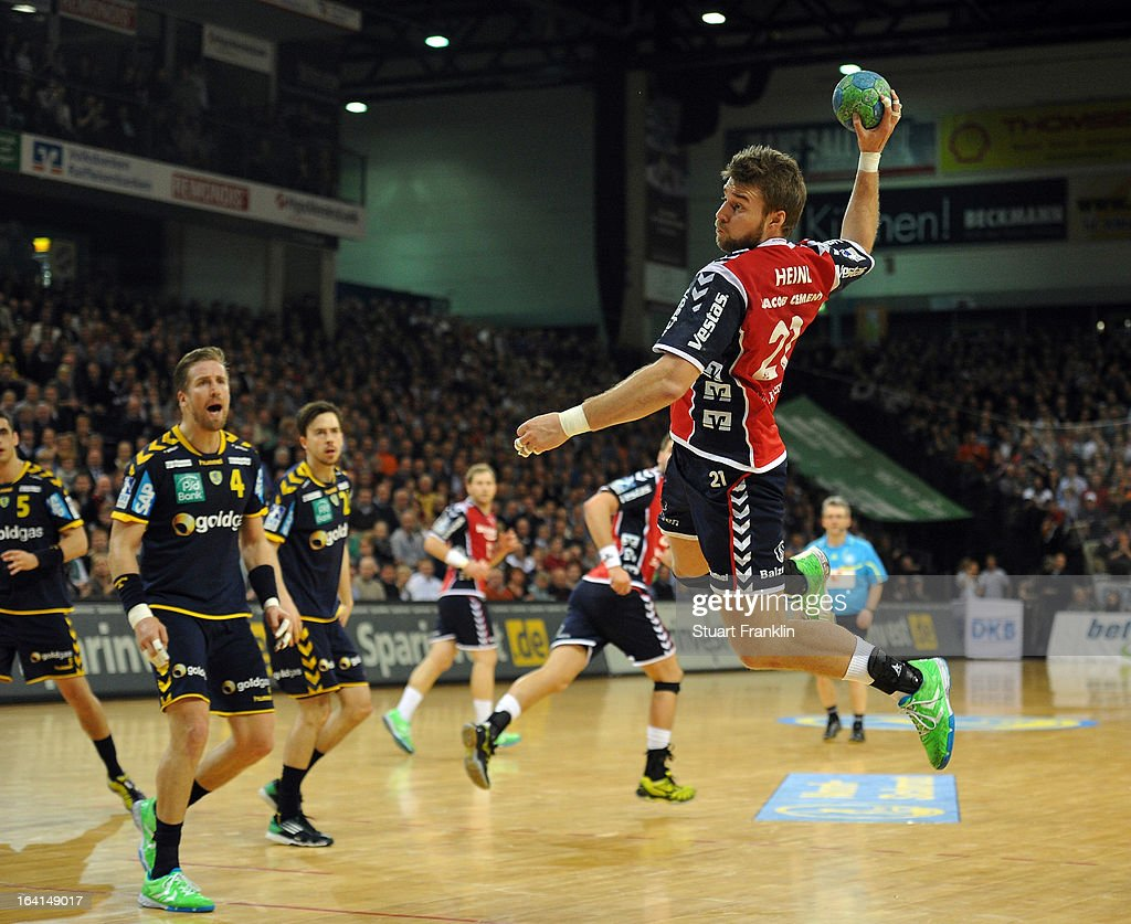 Jacob Henri of Flensburg throws a goal during the Toyota Bundesliga handball game between SG Flensburg-Handewitt and Rhein-Neckar Loewen at the Flens arena on March 20, 2013 in Flensburg, Germany.