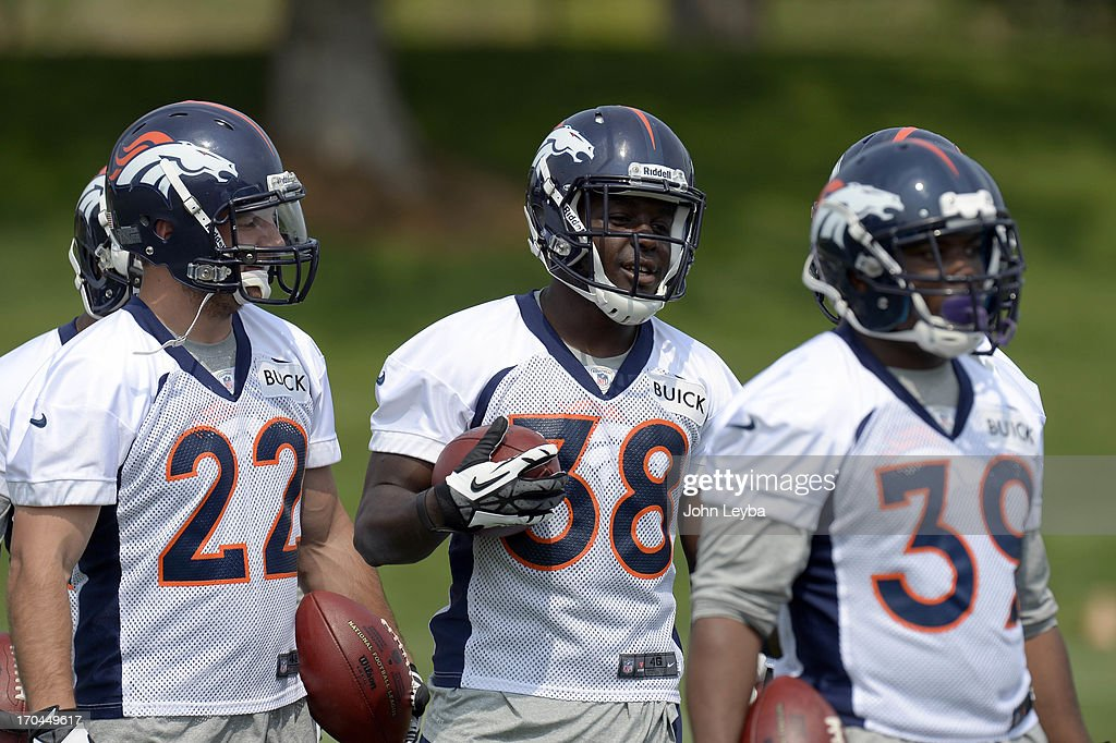 Jacob Hester (22) Montee Ball (38) and C.J. Anderson (39) RB's of the Denver Broncos run through drills during the last day of minicamp June 13, 2013 at Dove Valley.
