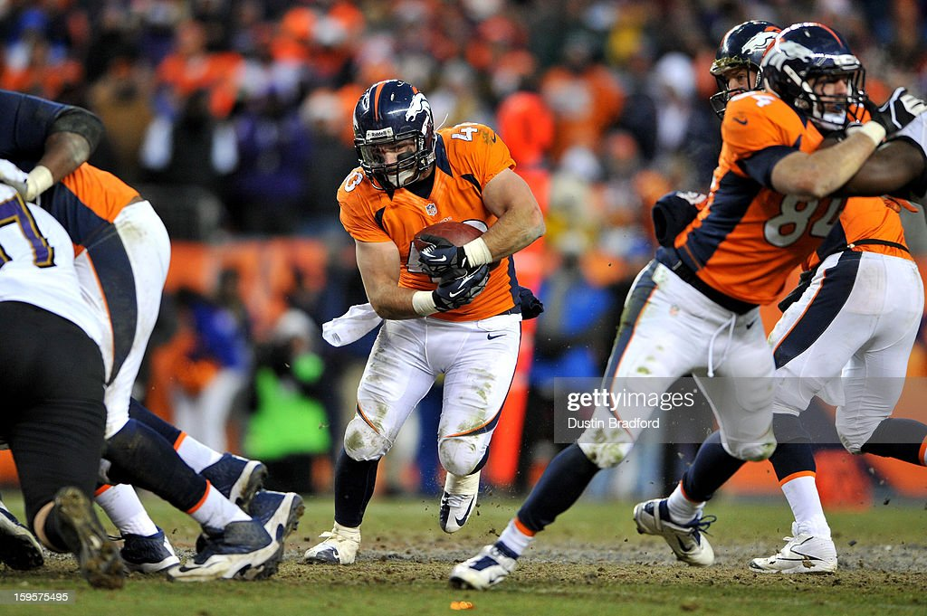 <a gi-track='captionPersonalityLinkClicked' href=/galleries/search?phrase=Jacob+Hester&family=editorial&specificpeople=2109848 ng-click='$event.stopPropagation()'>Jacob Hester</a> #40 of the Denver Broncos runs the ball against the Baltimore Ravens during the AFC Divisional Playoff Game at Sports Authority Field at Mile High on January 12, 2013 in Denver, Colorado. The Ravens won 38-35 in 2 overtimes.