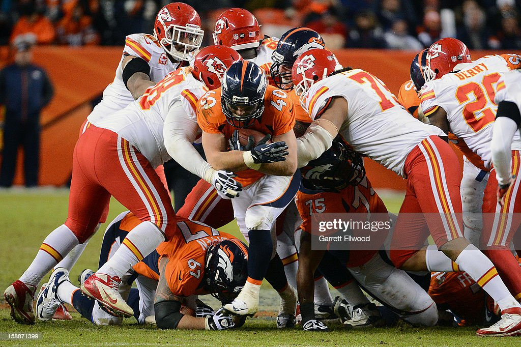 Jacob Hester #40 of the Denver Broncos runs trough the defensive line of the Kansas City Chiefs during the game at Sports Authority Field at Mile High on December 30, 2012 in Denver, Colorado.