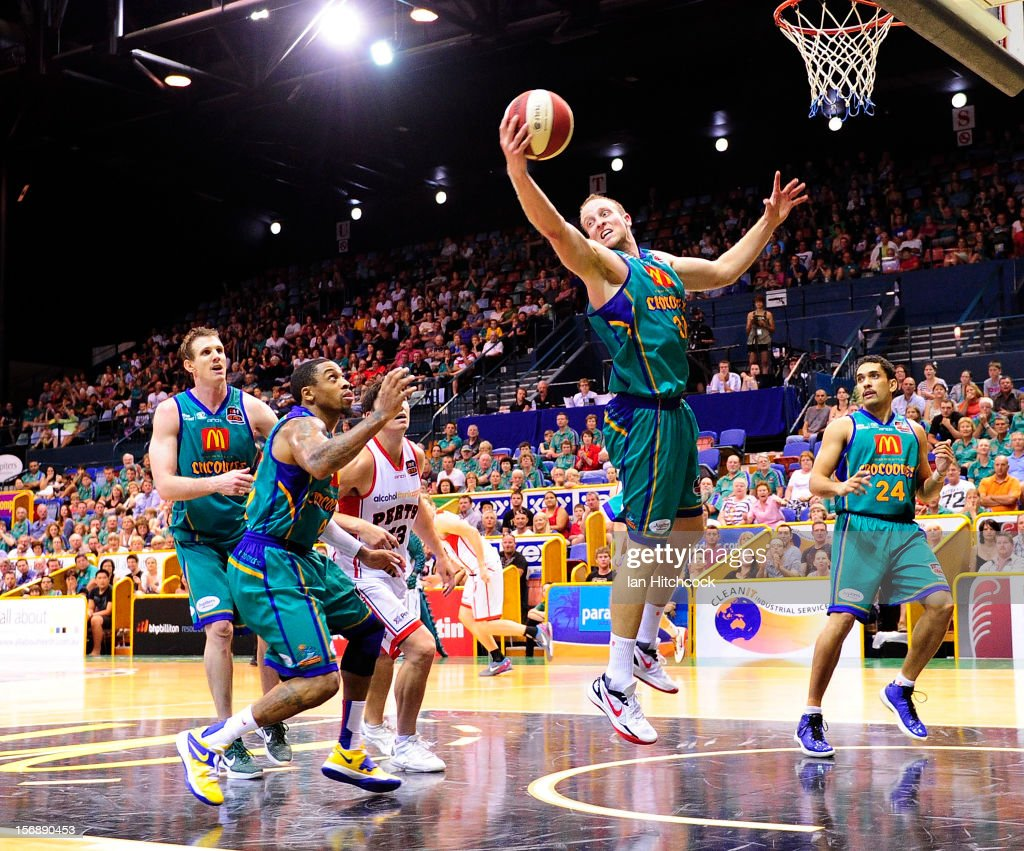 Jacob Holmes of the Crocodiles catches a rebound during the round eight NBL match between the Townsville Crocodiles and the Perth Wildcats at Townsville Entertainment Centre on November 24, 2012 in Townsville, Australia.