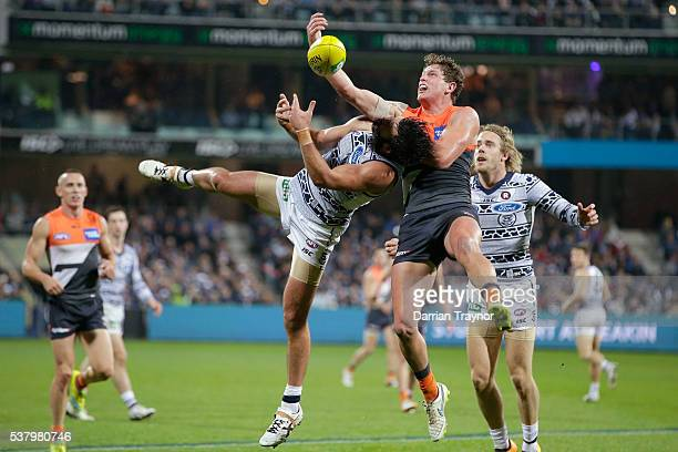 Jacob Hopper of the Giants and Jimmy Bartel of the Cats collide during the round 11 AFL match between the Geelong Cats and the Greater Western Sydney...