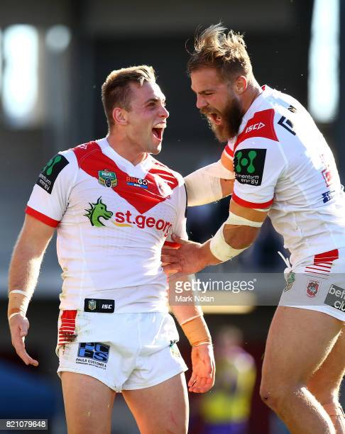 Jacob Host of the Dragons celebrates with team mate Jack De Belin after scoring during the round 20 NRL match between the St George Illawarra Dragons...
