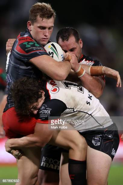 Jacob Host of the Dragons is tackled during the round four NRL match between the St George Illawarra Dragons and the New Zealand Warriors at UOW...
