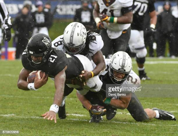 Jacob Huff and Duke McGhee of of the Minnesota Golden Gophers tackles Justin Jackson the Northwestern Wildcats during the first half on November 18...