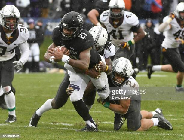 Jacob Huff of the Minnesota Golden Gophers tackles Justin Jackson of the Northwestern Wildcats during the first half on November 18 2017 at Ryan...