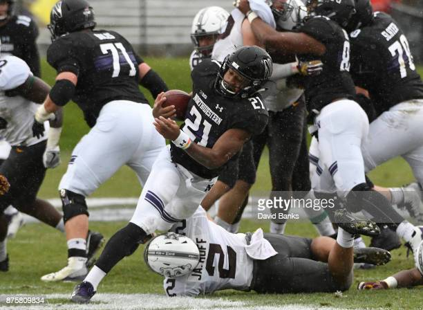 Jacob Huff of the Minnesota Golden Gophers tries to tackle Justin Jackson of the Northwestern Wildcats during the first half on November 18 2017 at...