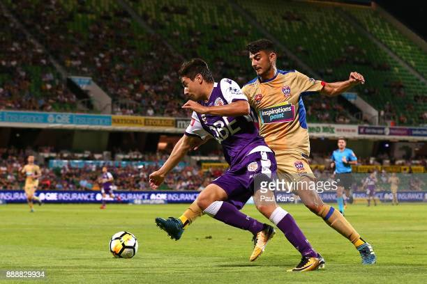 Jacob Italiano of the Glory and John Koutroumbis of the Jets contest for the ball during the round 10 ALeague match between the Perth Glory and the...