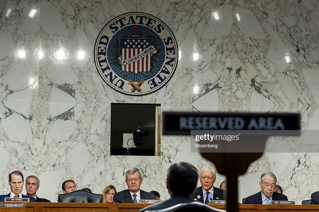 Jacob 'Jack' Lew, U.S. treasury secretary, center, testifies before Senator Ron Wyden, a Democrat from Oregon, from left, Senator Max Baucus, a Democrat from Montana and chairman of the Senate Finance Committee, Senator Orrin Hatch, a Republican from Utah, in Washington, and Senator Charles Grassley, a Republican from Iowa, during a Senate Finance Committee on Capitol Hill in Washington, D.C., U.S., on Thursday, Oct.10, 2013. Lew warned that the congressional deadlock over the U.S. debt ceiling is 'beginning to stress the financial markets,' and failing to raise it by Oct. 17 could put Social Security and Medicare payments at risk. Photographer: Pete Marovich/Bloomberg via Getty Images