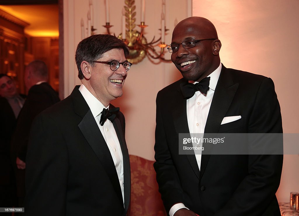 Jacob 'Jack' Lew, U.S. treasury secretary, left, and Reggie Love, former assistant to U.S. President Barack Obama, attend the Bloomberg Vanity Fair White House Correspondents' Association (WHCA) dinner afterparty in Washington, D.C., U.S., on Saturday, April 27, 2013. The 99th annual dinner raises money for WHCA scholarships and honors the recipients of the organization's journalism awards. Photographer: Andrew Harrer/Bloomberg via Getty Images