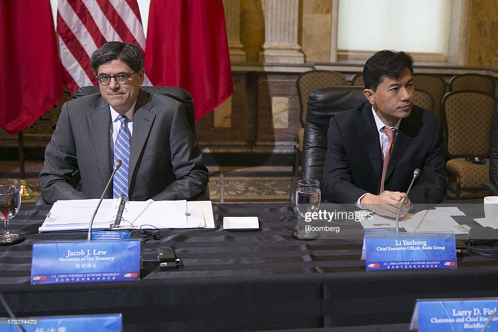Jacob 'Jack' Lew, U.S. treasury secretary, left, and Robin Li, chief executive officer of Baidu Inc., attend a chief executive officer roundtable with U.S. and Chinese business leaders during the U.S.-China Strategic and Economic Dialogue (S&ED) conference at the Treasury Department in Washington, D.C., U.S., on Thursday, July 11, 2013. The U.S. and China are meeting this week to find ways to balance a wider flow of investment and goods as their central banks try to prevent excessive risk-taking from derailing the world's biggest economies. Photographer: Andrew Harrer/Bloomberg via Getty Images