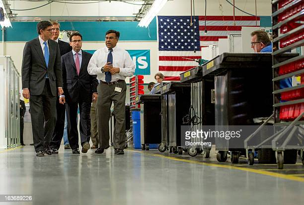 Jacob 'Jack' Lew US treasury secretary left Helmuth Ludwig chief executive officer of Siemens Industry Inc center and Shujath Ali engineering manager...