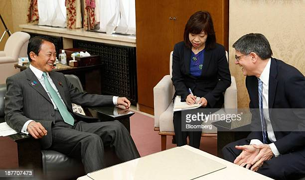 Jacob 'Jack' Lew US treasury secretary right speaks with Taro Aso Japan's finance minister left during a meeting in Tokyo Japan on Tuesday Nov 12...