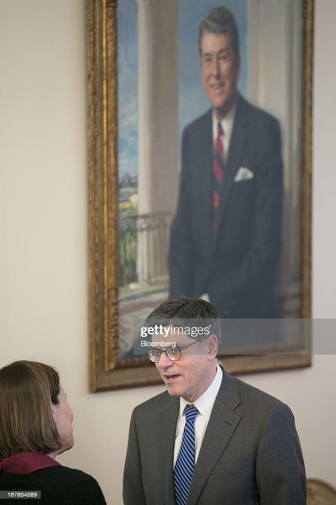 Jacob 'Jack' Lew, U.S. treasury secretary, talks near a painting of former President Ronald Reagan following an announcement by U.S. President Barack Obama in Washington, D.C., U.S. on Wednesday, May 1, 2013. President Barack Obama nominated Representative Mel Watt to be director of the Federal Housing Finance Agency after months of political pressure from consumer advocates to find a new overseer for Fannie Mae and Freddie Mac. Photographer: Andrew Harrer/Bloomberg via Getty Images
