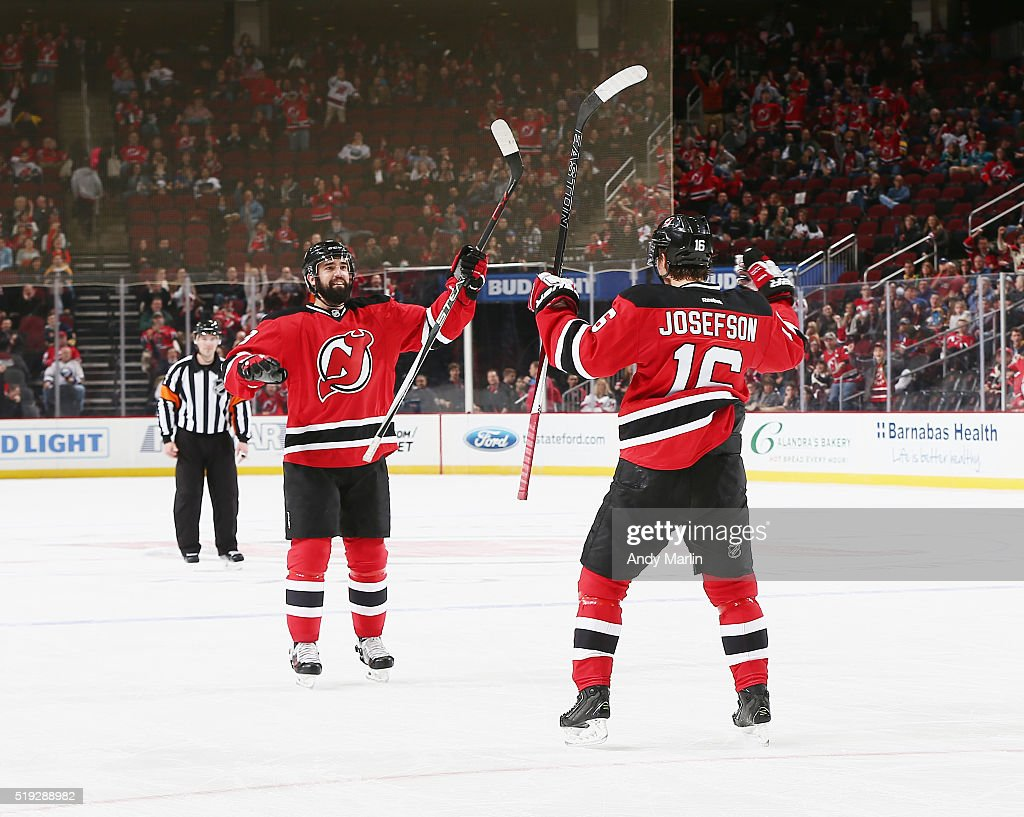 Jacob Josefson and David Schlemko of the New Jersey Devils react after Josefson scored a during the game against the Buffalo Sabres at the Prudential...