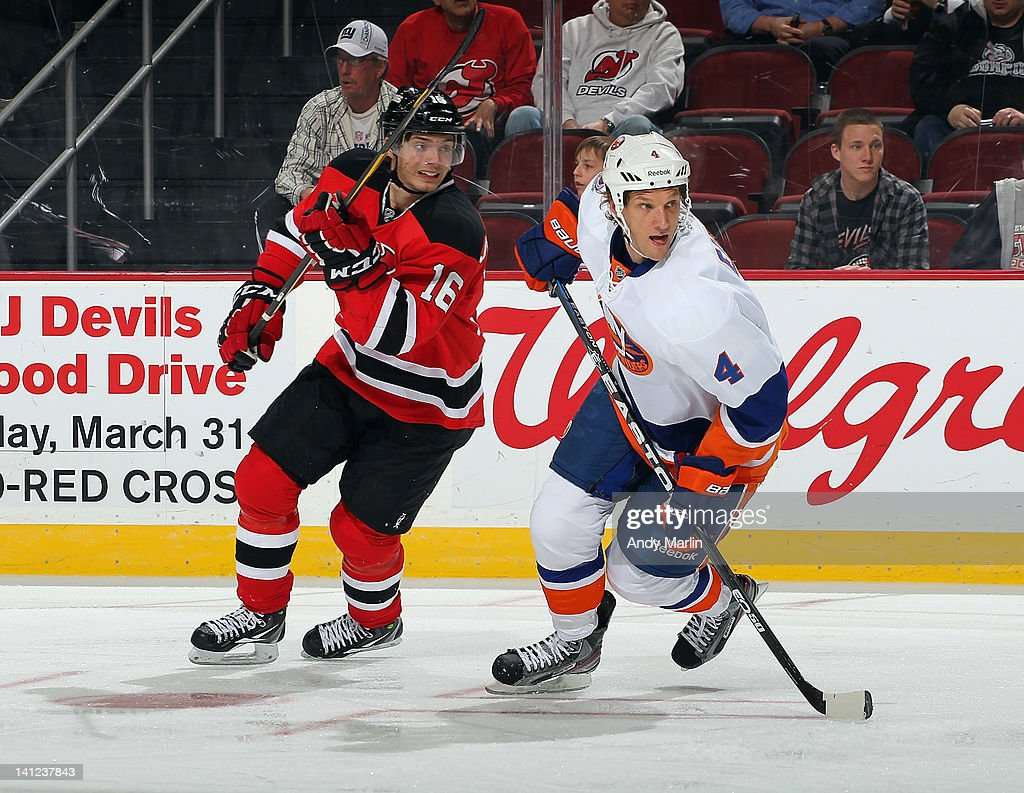 Jacob Josefson #16 of the New Jersey Devils and Mark Eaton #4 of the New York Islanders skate for position during the game at the Prudential Center on March 8, 2012 in Newark, New Jersey.
