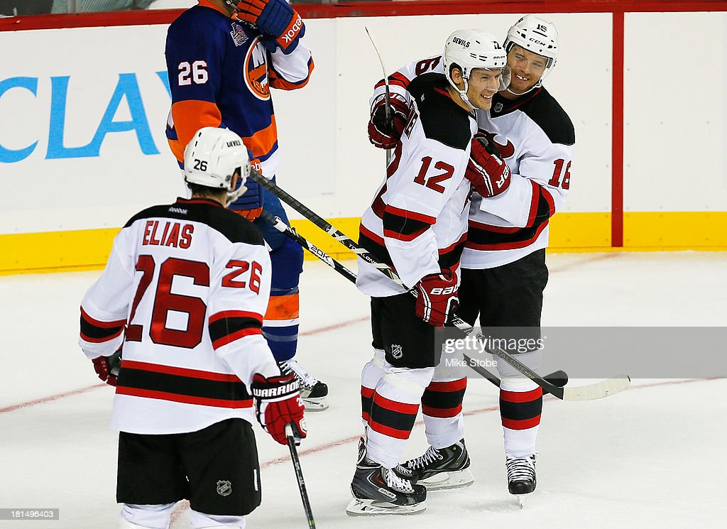 Jacob Josefson #16 of the New Jersey Devils celebrates his first period goal with teamates Damien Brunner #12 and Patrik Elias #26 during the game against the New York Islanders at Barclays Center on September 21, 2013 in the Brooklyn borough of New York City. Devils defeated the Islanders 3-0.