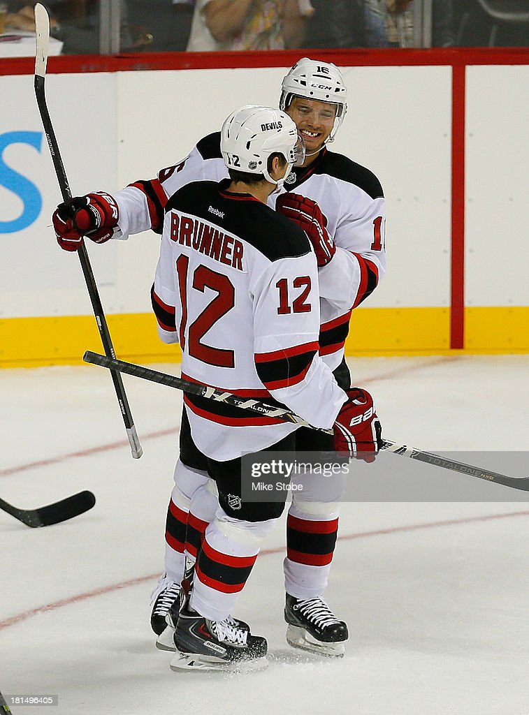 Jacob Josefson #16 of the New Jersey Devils celebrates his first period goal with teamates Damien Brunner during the game against the New York Islanders at Barclays Center on September 21, 2013 in the Brooklyn borough of New York City. Devils defeated the Islanders 3-0.