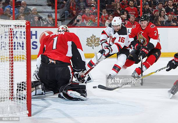 Jacob Josefson of the New Jersey Devils drives the puck to the net on a scoring chance against Mike Condon and Dion Phaneuf of the Ottawa Senators at...