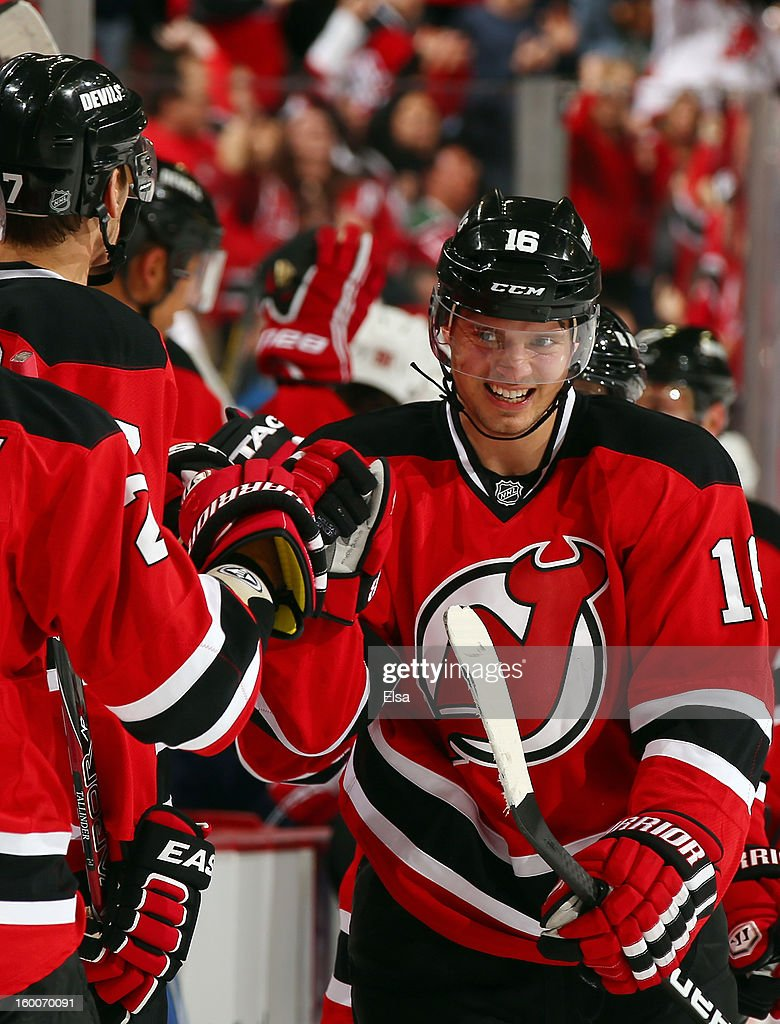 Jacob Josefson #16 of the New Jersey Devils is congratulated by teammates on the bench after he got the assist in a goal during the first period against the Washington Capitals at the Prudential Center on January 25, 2013 in Newark, New Jersey.