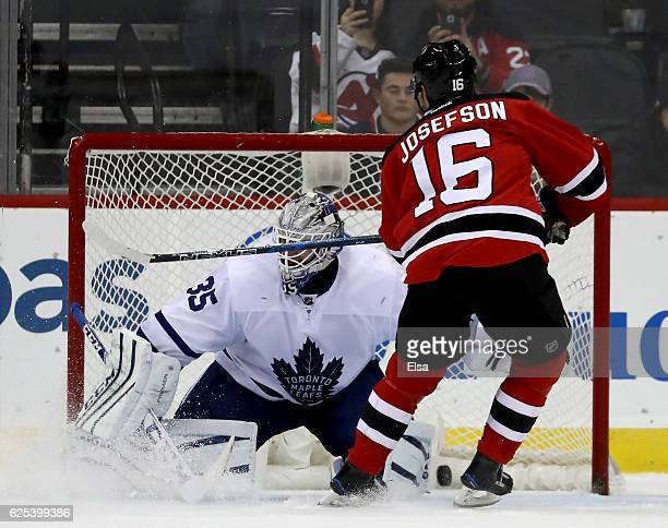 Jacob Josefson of the New Jersey Devils scores a goal in the overtime shootout against Jhonas Enroth of the Toronto Maple Leafs on November 23 2016...