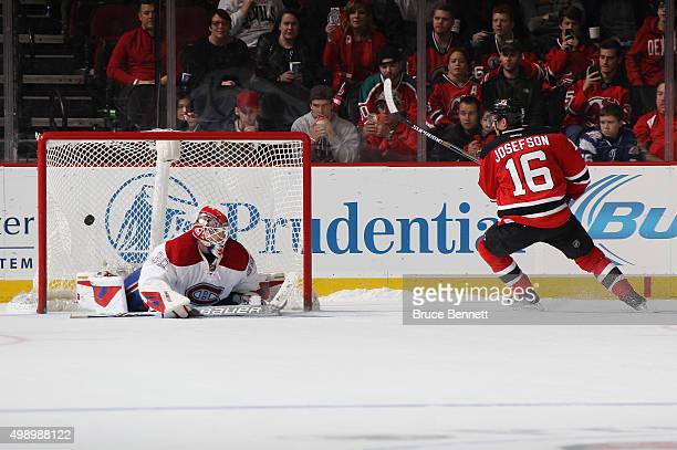Jacob Josefson of the New Jersey Devils scores on the shootout against Mike Condon of the Montreal Canadiens at the Prudential Center on November 27...