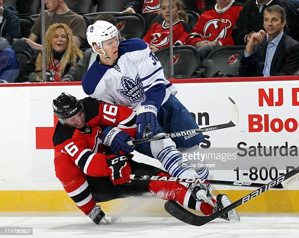Jacob Josefson of the New Jersey Devils takes a two minute penalty for holding Carl Gunnarsson of the Toronto Maple Leafs at the Prudential Center on...