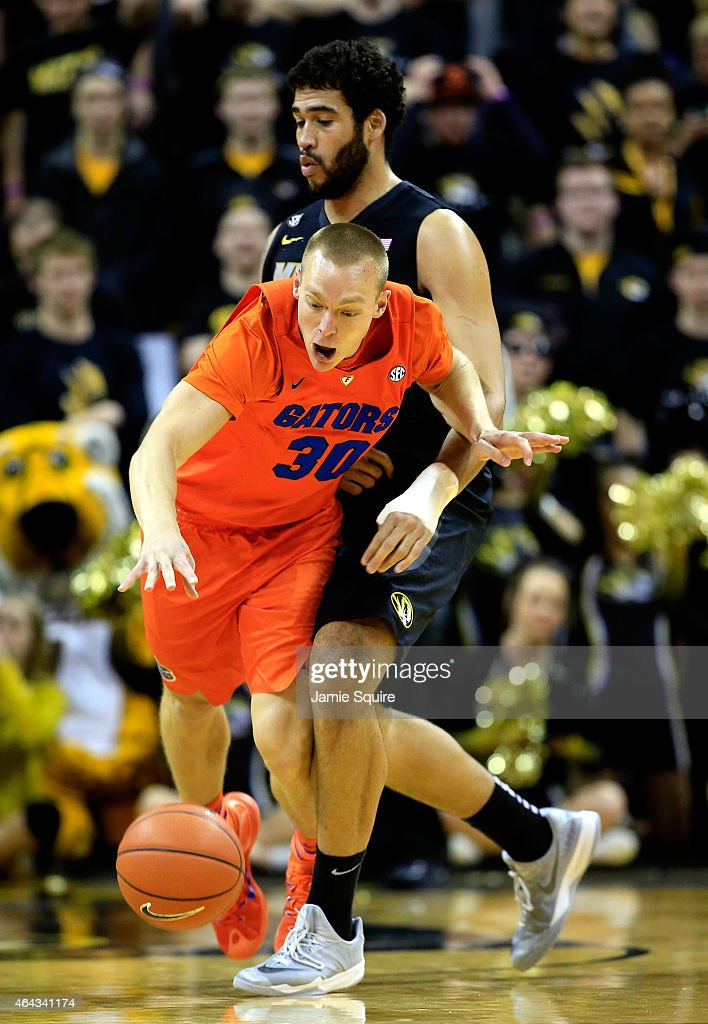 Jacob Kurtz of the Florida Gators is tripped by Keanau Post of the Missouri Tigers during the game at Mizzou Arena on February 24 2015 in Columbia...