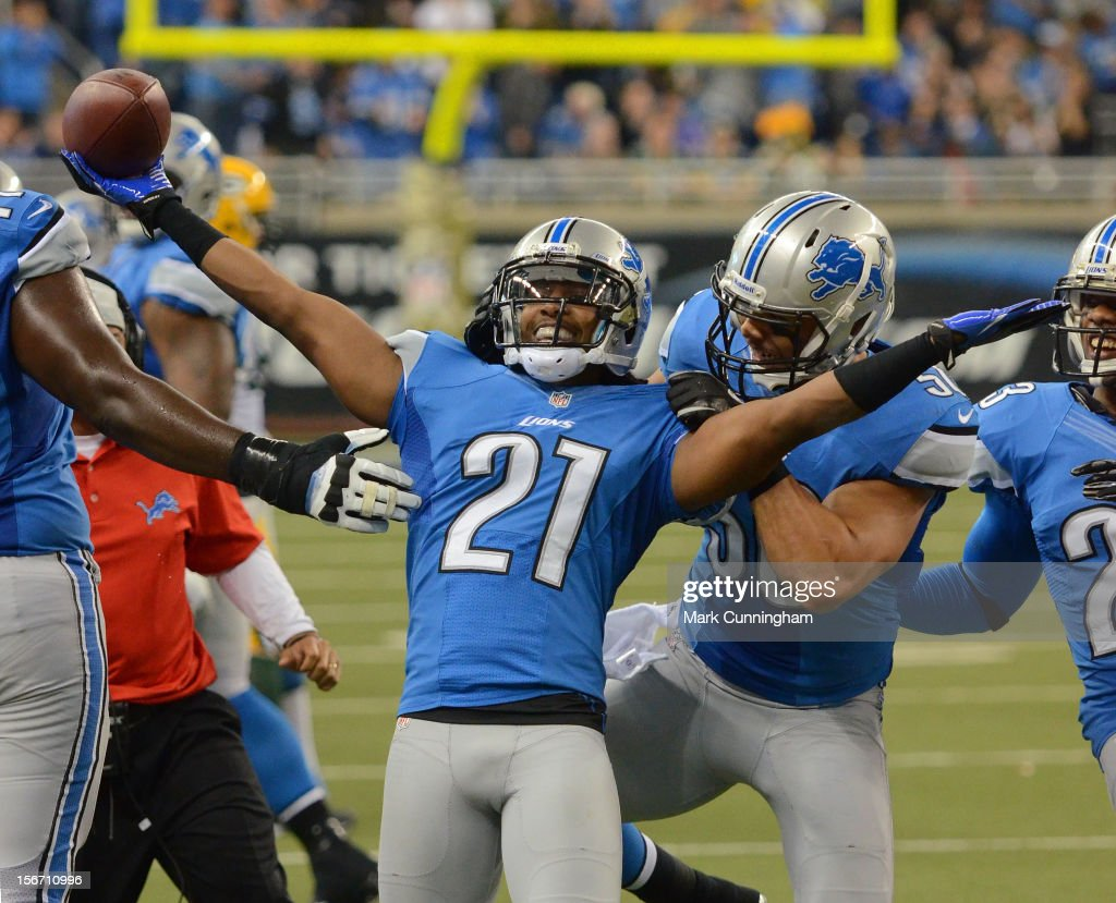Jacob Lacey #21 of the Detroit Lions celebrates an interception during the game against the Green Bay Packers at Ford Field on November 18, 2012 in Detroit, Michigan. The Packers defeated the Lions 24-20.