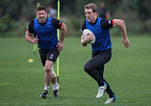 Jacob Lillyman chases Captain Ryan Hoffman during a New Zealand Warriors NRL training session at Mt Smart Stadium on July 27 2016 in Auckland New...