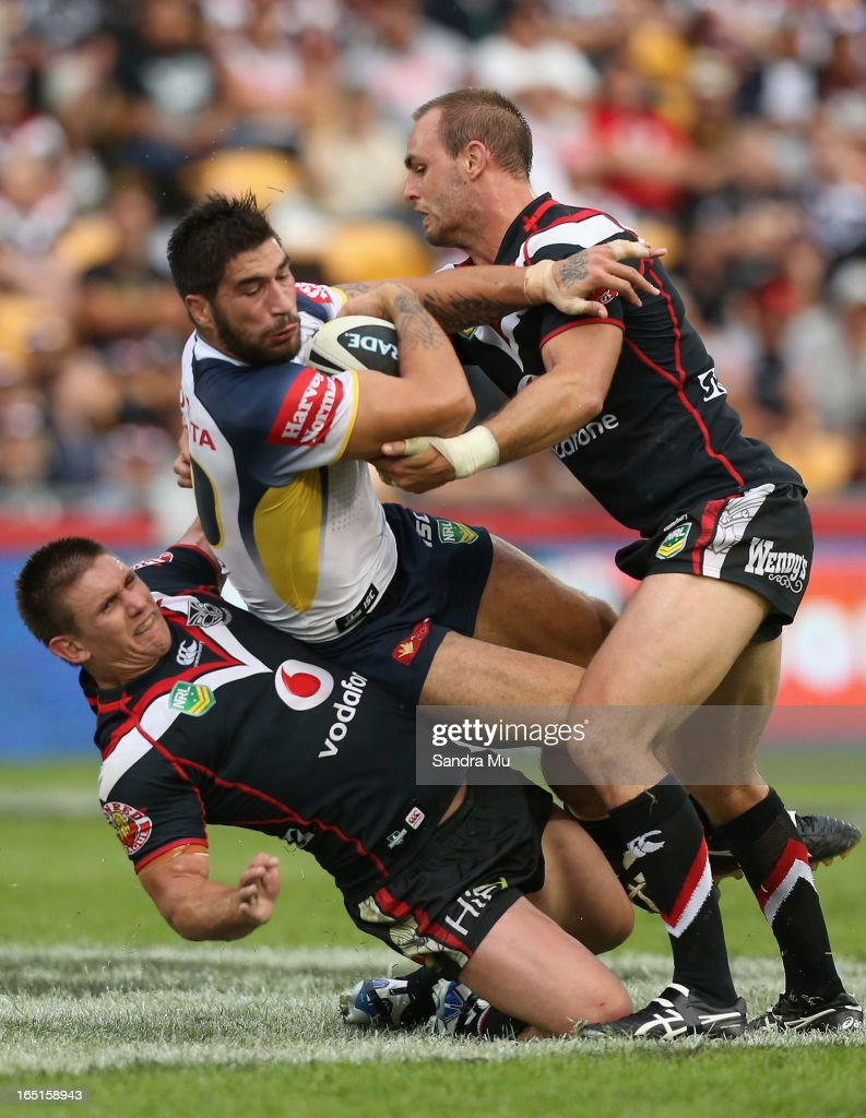 Jacob Lillyman of the Warriors (L) is caught in the tackle of James Tamou of the Cowboys by Simon Mannering of the Warriors during the round four NRL match between the New Zealand Warriors and the North Queensland Cowboys at Mt Smart Stadium on April 1, 2013 in Auckland, New Zealand.