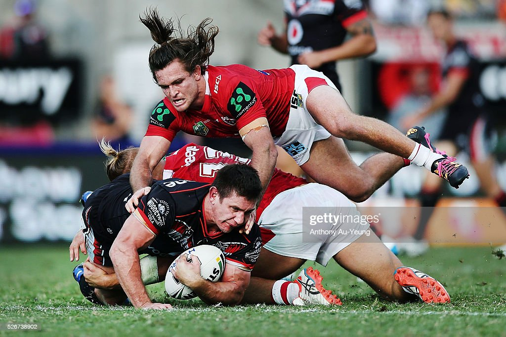 Jacob Lillyman of the Warriors is tackled by Mitch Rein of the Dragons during the round nine NRL match between the New Zealand Warriors and the St George Illawarra Dragons at Mt Smart Stadium on May 1, 2016 in Auckland, New Zealand.