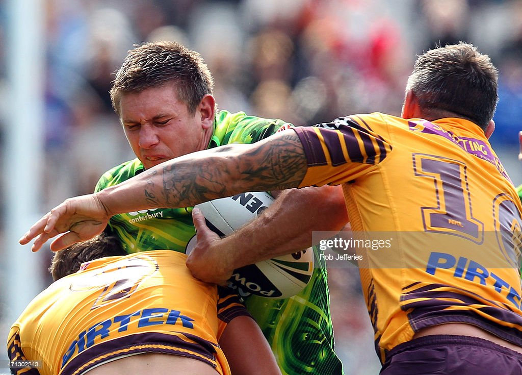 <a gi-track='captionPersonalityLinkClicked' href=/galleries/search?phrase=Jacob+Lillyman&family=editorial&specificpeople=729961 ng-click='$event.stopPropagation()'>Jacob Lillyman</a> of the Warriors is wrapped up by the Broncos defence during the NRL trial match between the Brisbane Broncos and the New Zealand Warriors at Forsyth Barr Stadium on February 23, 2014 in Dunedin, New Zealand.